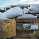 Detail of the pop-up museum shows a photograph and sand bags on Monday, Dec. 12, 2016, where history students at Montana State University use a dumpster to help illustrate World War I trench warfare for their class. The pop-up museum, located on MSU's Centennial Mall, across from the Renne Library, contains photographs, artifacts, and simulated trenches with informational posters of Montana's role in the World Wars. MSU Photo by Adrian Sanchez-Gonzalez