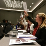 MSU student Emily Stimac, right, representing Hungary, votes at the Model United Nations Far West conference. MSU teams won top awards at the conference. Photo courtesy of Eric Raile.
