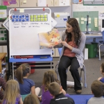MSU education major Laura Devenport reads with students at Hyalite Elementary.