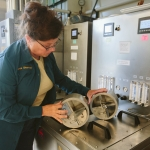 Jamie Sherman, associate professor of plant sciences and plant pathology in the College of Agriculture at Montana State University, demonstrates equipment to process and test malt barley on Thursday, June 1, 2017, in Bozeman, Mont. Sherman recently received a $350,000 grant from the U.S. Department of Agriculture National Institute of Food and Agriculture to research barley varieties grown in Montana. MSU Photo by Adrian Sanchez-Gonzalez