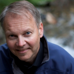 A portrait photo of event's speaker, Rob Davies