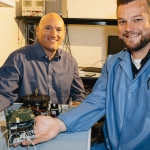 Brock LaMeres, associate professor in the Department of Electrical and Computer Engineering in the College of Engineering at Montana State University works with Connor Julien, an electrical engineering graduate student, on Tuesday, Sept. 5, 2017, on preparing electrical boards for a RadSat to be launched from the International Space Station in March 2018. MSU Photo by Adrian Sanchez-Gonzalez