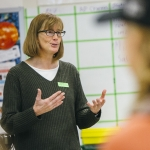 Sharlyn Izurieta, an outreach coordinator with the Gianforte School of Computing at Montana State University, talks with STEM students in Rachel White's science class at Belgrade High School, Thursday, March 2, 2017, in Belgrade, Mont.  MSU Photo by Adrian Sanchez-Gonzalez