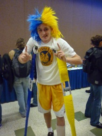 Dude with crazy blue-yellow hair and matching crutches