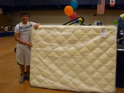 Dude posing with his new matress (seriously?)