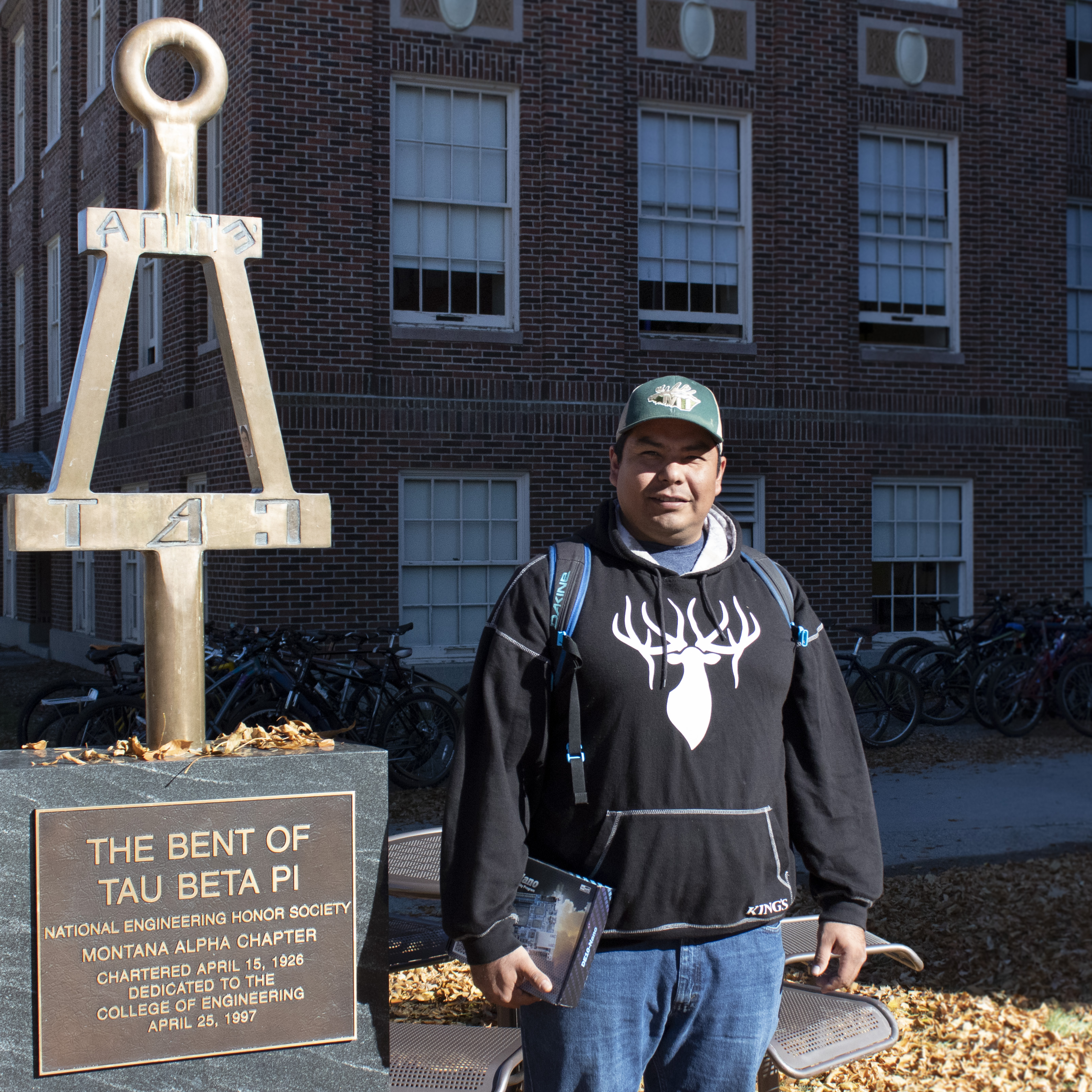 A picture of Randall beside the bent of tau beta phi