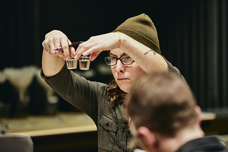 Andrea Stanley compares two wort samples at the 2019 Malt Cup