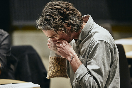 Evan Craine evaluates malt at the 2019 Malt Cup