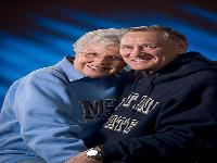 Duke (55) and Naomi (56) Hoiland. 50th anniversary portrait taken in MSU gear. They met at MSU.