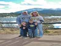 Colorado Springs, CO -- December photo in front of Pike's Peak; Erin and Mike Anderson, Darin and Sydney