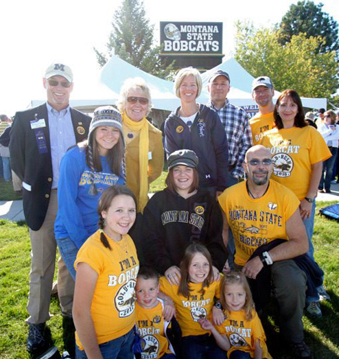 Dave Johnson, designer of the 2015 Gold Rush Shirt, with his family at Gold Rush.