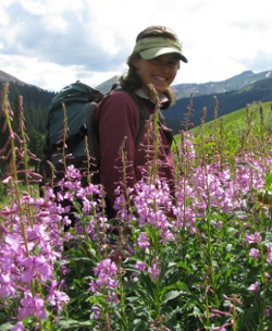 laura burkle standing in front of purple mountain flowers