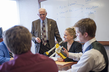 Professor Gary Bishop working with students in his pro bono consulting course