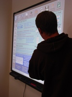 Student in front of a smart board