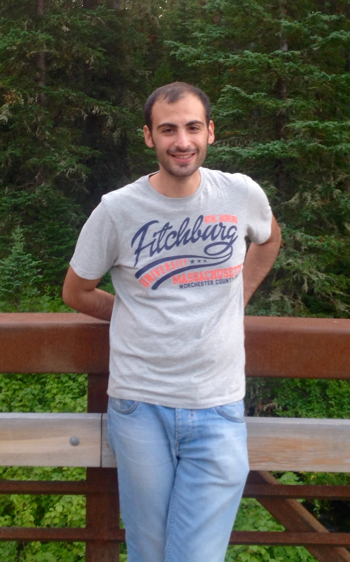 Amir Jafari standing if front of a forest