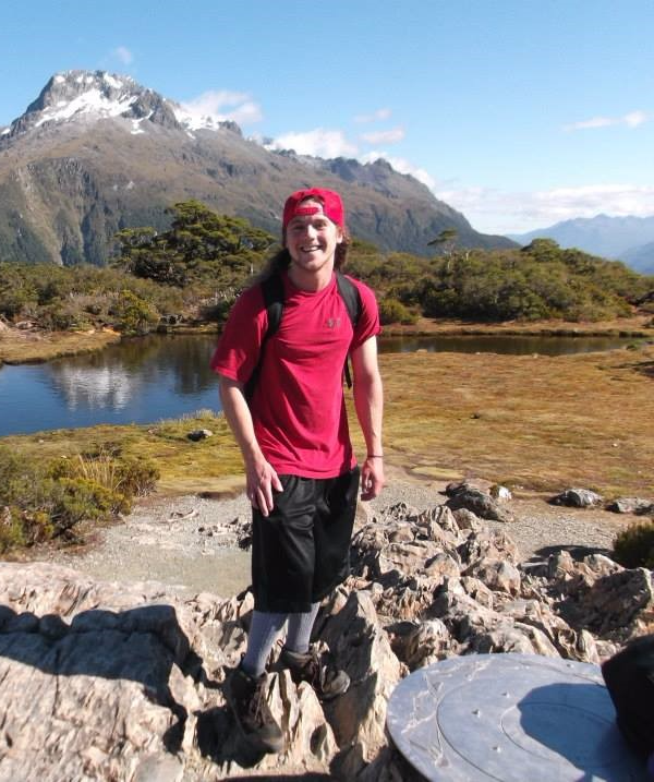 Cody West standing in front of a mountain