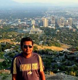 Fahmid Hossain Standing facing the camera overlooking bozeman