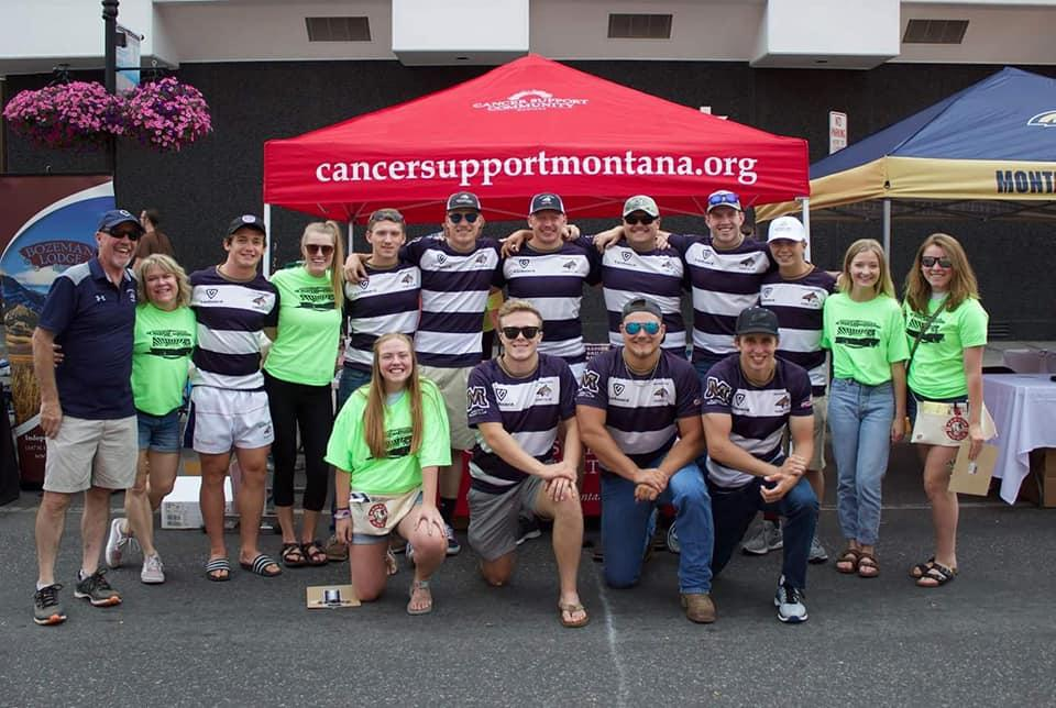 Men's Rugby Club doing community service work at Bozeman's annual car show.