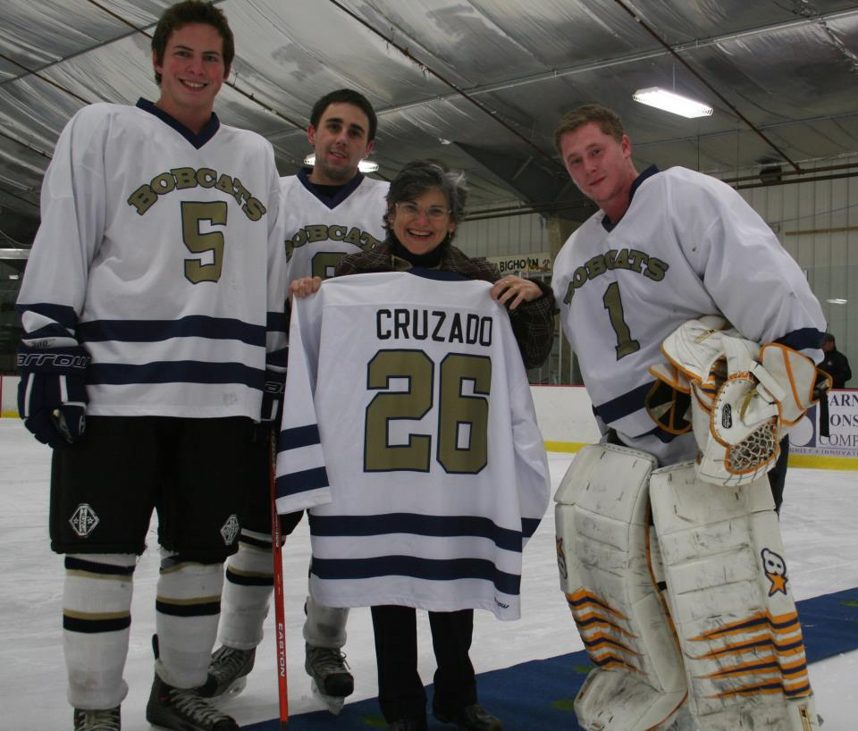 hockey club members with president cruzado