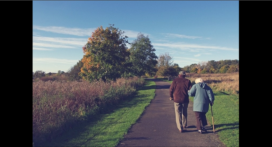 Couple walking along path