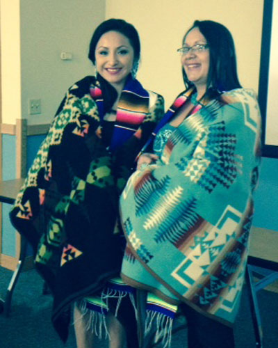 two nurses receiving their blanket