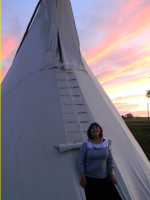 Nurse in front of Tepee