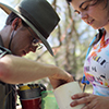 Charles Hart and Kayla Arend remove samples from a trapping container they set in Eastern Montana. (Photo by Frank Etzler).