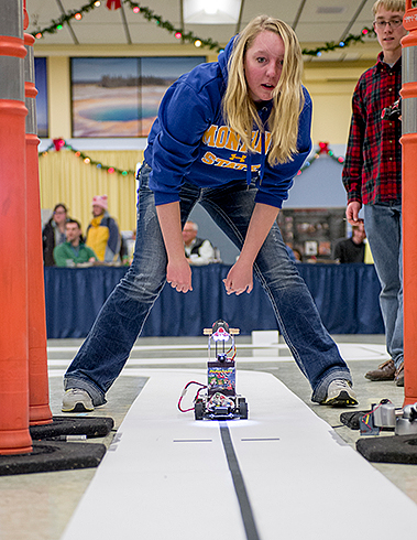 Freshman electrical and computer engineering student Rachel Gunnink starts her autonomous race car during the Freescale Cup Race Thursday, December 5, 2013 in the Strand Union Building. In this competition, students must program the cars to follow a track by running programs on microprocessors. MSU photo by Kelly Gorham.