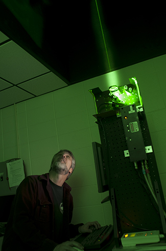 Joseph Shaw, Montana State University professor in electrical and computer engineering, works with a LIDAR (light detection and ranging) laser at MSU's engineering complex. Starting next fall, Montana State University will offer a master's degree and a minor in optics and photonics, emphasizing one of the university's strengths. Approved Friday by the Montana Board of Regents, the programs will build on Bozeman's growing reputation as a center of creativity and commercialization in the field of laser and imaging optics.  MSU Photo by Kelly Gorham.