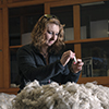 Sarah Boyer of Livingston grades wool in MSU's Wool Lab. She and other members of the MSU Wool Judging Team will compete on St. Patrick's Day at the Houston Livestock Show and Rodeo. (MSU photo by Kelly Gorham).