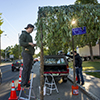Montana State University College of Agriculture senior landscape design student Austin Chapin puts finishing touches on a foliage canopy along College Street Friday, September 20, 2013 as part of International Parking Day in Bozeman, Mont. MSU photo by Kelly GorhamMSU photo by Kelly Gorham