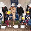 Montana State University broke ground for its new Jabs Hall during a ceremony held Friday at the building site north of Montana Hall. Pictured here, from left, are Lindsay Murdock, ASMSU president; Montana Lt. Gov. John Walsh; MSU President Waded Cruzado; Jake Jabs; MSU Jake Jabs College of Business and Entrepreneurship Dean Kregg Aytes; Angela McLean, chairwoman of the Montana Board of Regents, and local children. MSU photo by Kelly Gorham.