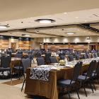 Image of long table at extream angle with round tables in background.