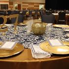 Image of table decoration on round table with number 27.