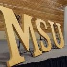 Image of MSU letters with podium on stage.
