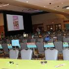 Image of decorated long table with rows of long tables in the background and a screen in the background.
