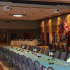 Image of decorated long table. with balloons in the background.
