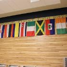 Image of international flags on wall.