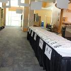 Image of entrance table with numbers for patrons.