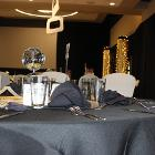 Low angle image of decorated table with mirror ball as center piece.