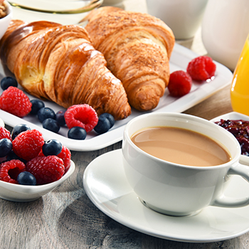 croissants, mixed berries, and a cup of coffee