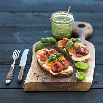 bruschetta on a wooden platter