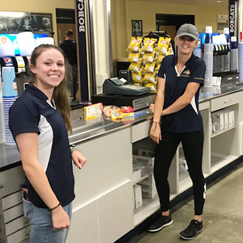 two girls working at the concession stands