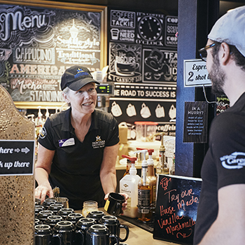 student ordering from a staff member at a coffee shop