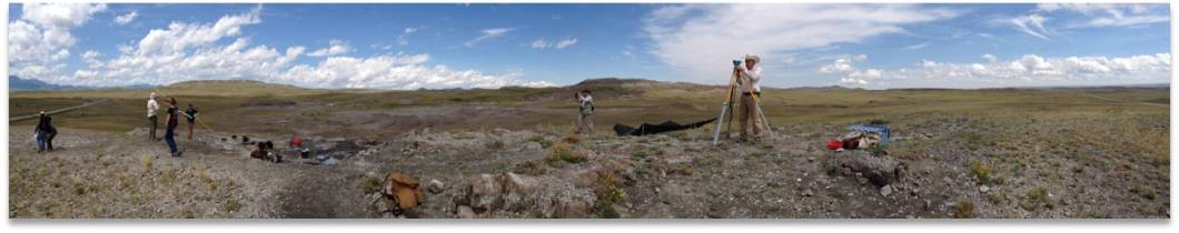 Paleontologists using survey equipment in eastern Montana