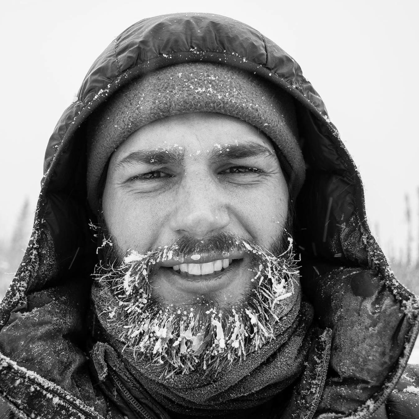 Black and white photo of Kyle with a frozen beard