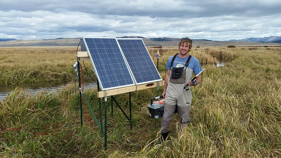 Jason Marsh with solar panels in the field