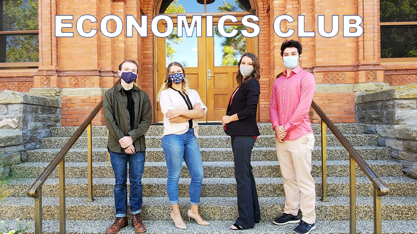 Four Economics club officers are shown outside of Montana Hall on the MSU campus.