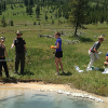 Students sampling hot springs to characterize microbes that live in extreme conditions. (B. Peyton lab, photo Extended University)
