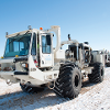 Vibroseis trucks lined up during seismic survey used to investigate subsurface around project site in north central Montana